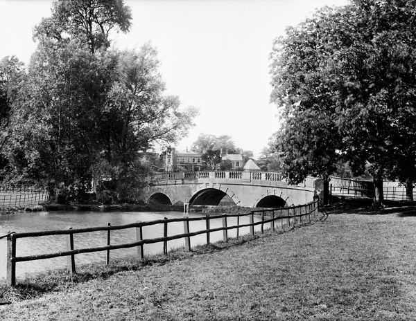 WHITEKNIGHTS PARK, Reading, Berkshire. A landscape view in the park showing the ornamental bridge over the lake. The house can be seen in the background. Photographed in 1890 by Henry Taunt