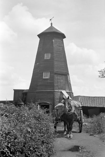 WINDMILL, Crowfield, Suffolk. This smock mill was originally constructed as a drainage mill near Yarmouth, but was moved and converted to be used as a cereal mill in about 1840. In 1916 its cap was blown off and it continued with an engine until 1935