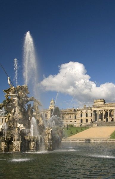 WITLEY COURT AND GARDENS, Worcestershire. View of the Perseus and Andromeda fountain in full flow showing the house beyond