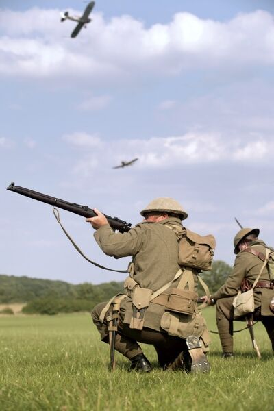 "FESTIVAL OF HISTORY, Kelmarsh Hall, Northamptonshire. World War I British ground soldiers defend the ""Kelmarais"" airfield during an attack by German aircraft. Soldier aiming rifle. 2007 re-enactment event"