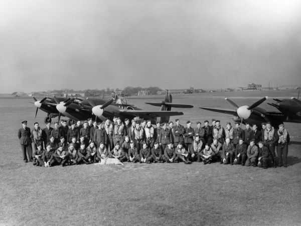 Group photograph of the pilots and ground crew of 137 Squadron with Westland Whirlwind fighter-bombers and the squadron mascot