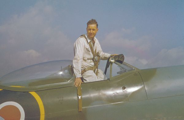 Test pilot Alex Henshaw in the cockpit of a Spitfire, 1944