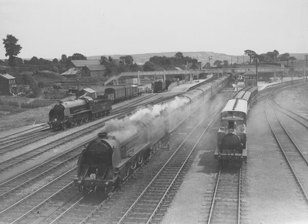 Southern Railway King Arthur Class N15 locomotive E451 Sir Lamorack with an express passing a S15 824 light engine and 0-4-2 D Class on a local train