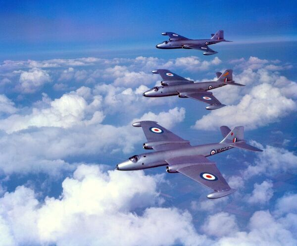 Two Canberra B.2 aircraft of 61 Squadron with a Canberra B.2 of 109 Squadron between them, flying from RAF Upwood 15 July 1955