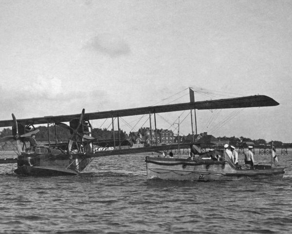 A motor launch approaching a Felixstowe F.2A flying Boat at RAF Lee-on-Solent, 1918