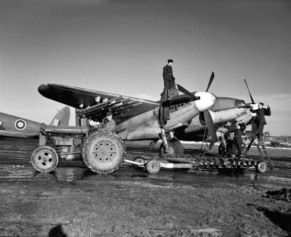 De Havilland Mosquito FB.VI of 143 Squadron Royal Air Force being prepared for flight, Banff February 1945