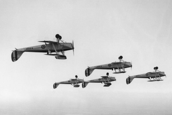 De Havilland Tiger Moth aircraft of the Central Flying School flying inverted, rehearsing for the RAF Display, Wittering 13 June 1932