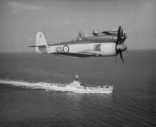 Hawker Sea Fury F.10 and FB.11 aircraft of 805 Squadron flying over HMAS Sydney 8 February 1949