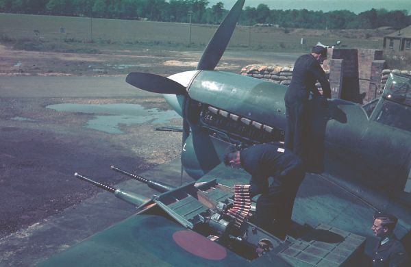 Armourers reloading the Hispano cannons of a Hawker Typhoon IB of 257 Squadron, RAF Warmwell 13 May 1943