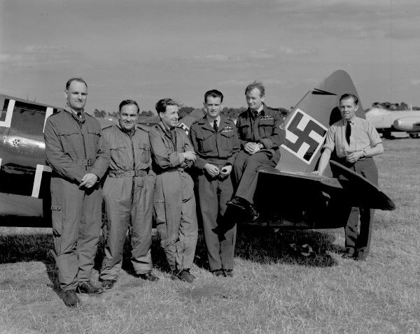 Pilots of 5 and 17 Squadron, left to right, Flt Lt D. White, Fg Off F. Bernard, Flt Lt D. Yeardley, Sqdn Ldr R. Noble and Polish pilot PII R.B. Barnes, flew Spitfires painted to represent Me109s in reconstruction of attack on Amiens prison at RAF Display