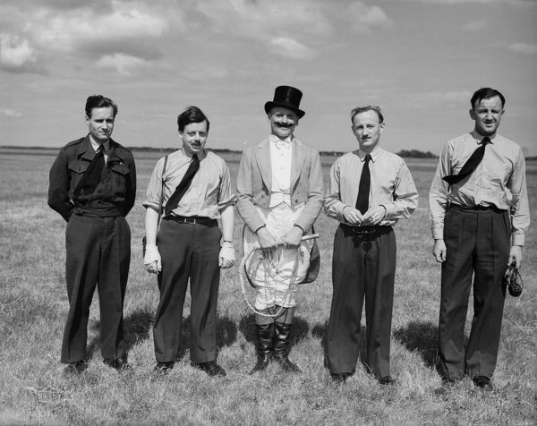 Pilots and ringmaster for Hoverfly display, left to right, Wg Cdr L.P. Gibson, Sqdn Ldr A. St J. Price, FS J.D. Hayhow (ringmaster), Sqdn Ldr R.F. Martin and Fg Off A.C. Capper, RAF display at Farnborough, 1950