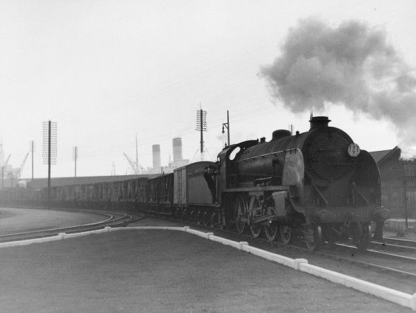 Southern Railway Class S15 4-6-0 locomotive with a freight train at Southampton Docks