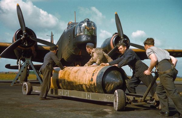 Manhandling a 4000 lb on its trolley in front of a Vickers Wellington III of 419 Squadron RCAF, RAF Mildenhall 27 May 1942