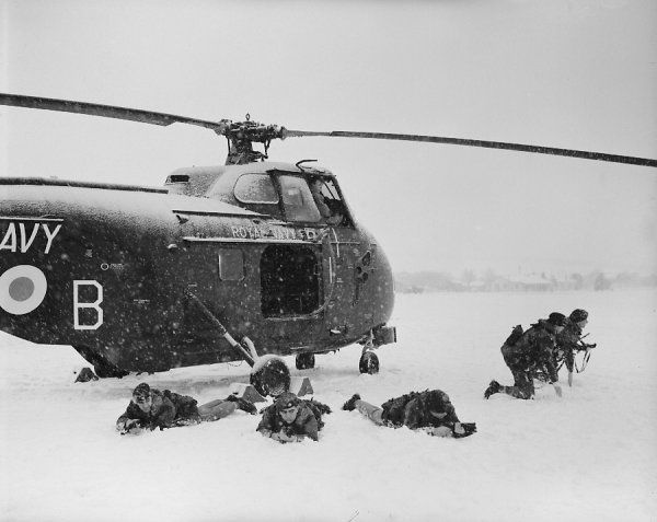 Westland Whirlwind HAS.7 of 848 Squadron from HMS Bulwark, with Royal Marine Commandos in the snow at Worthy Down, December 1959