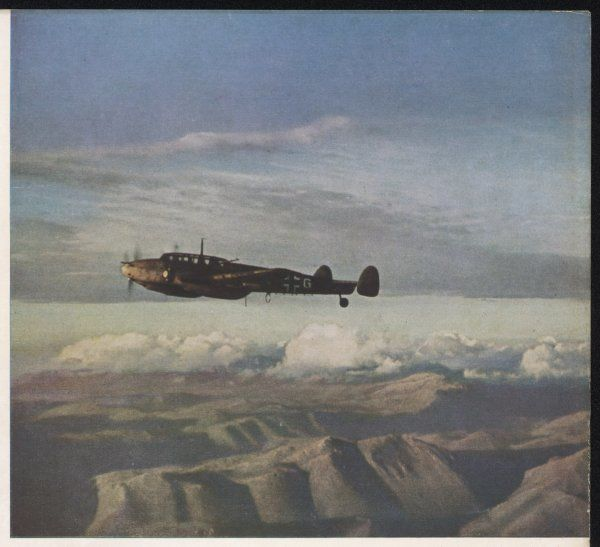 Italy ; a German twin-engined Messerschmitt 110 fighter over the mountains of Sicily : german aircraft came to help the Italians eject the Allies from the Mediterranean