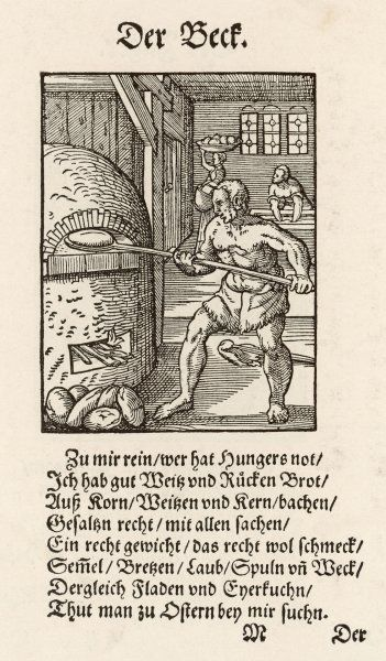 A 16th century baker loading his furnace with loaves
