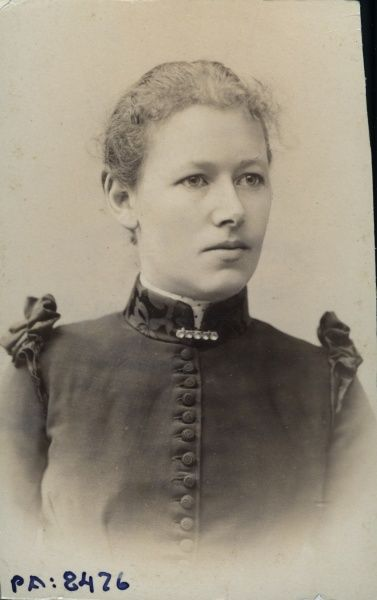 Studio portrait of an 18 year old girl, about 1900. Date: 1900