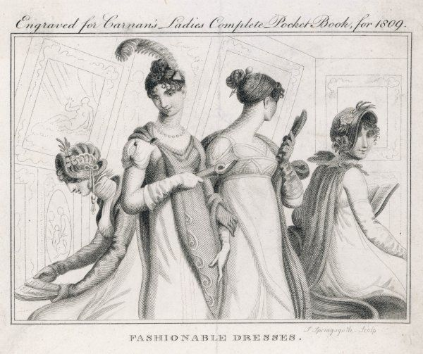Four ladies in a gallery wear fashionable dresses some of which show a marked classical influence including a cloak that fastens on one shoulder with a brooch