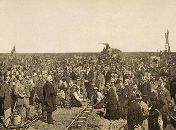 The Union Pacific Railroad, the first transcontinental rail link, is completed at Promontory Point, Utah - Hold still, everyone, for the photographer ! Date: 10 May 1869