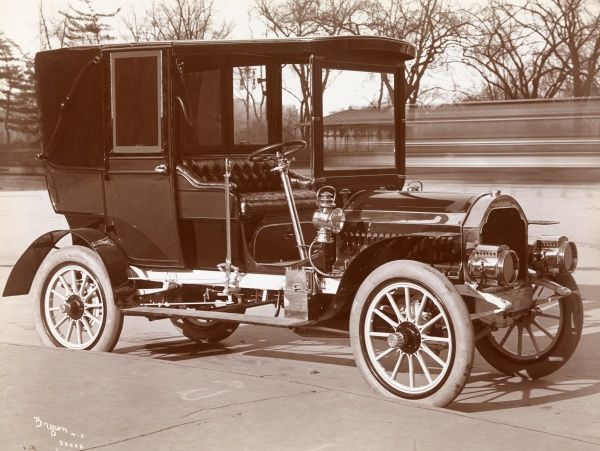 Automobile (Cars). 1905 Pierce Great Arrow automobile parked outside in or near a park (Central Park?)