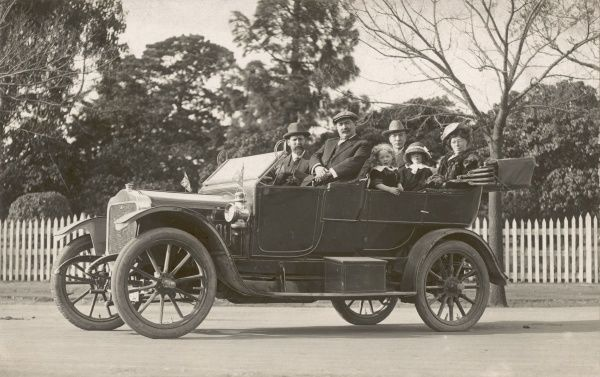 People driving a vintage motor car in Australia in 1914