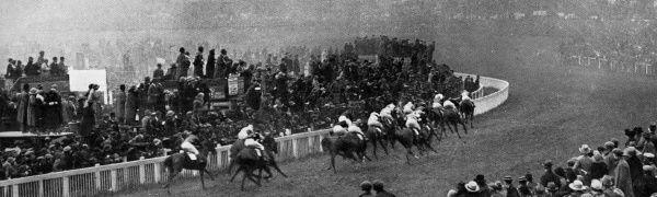 The 1923 Epsom Derby runners hug the rail as they round Tattenham Corner. In the lead is eventual winner Papyrus, with jockey Steve Donoghue on his way to a third successive victory in the race. Date: June 1923