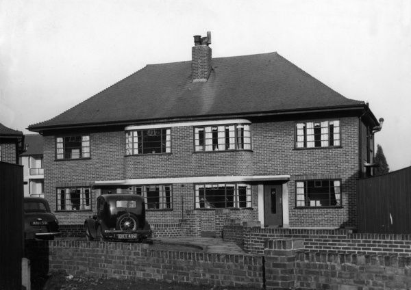 A typical example of 1930s housing, showing a pair of semi-detatched houses with rounded bays and the typical landscape windows of the period