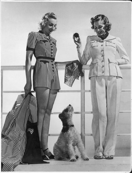 Striped playsuit with shorts with matching 3/4 length coat or a linen suit with trousers & jacket with large patch pockets. A wire-haired fox terrier sits nearby