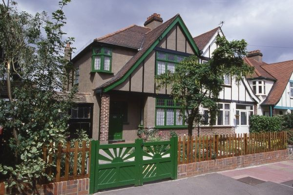 A typical British suburban semi-detached house with green paintwork, actually No. 17, Braemar Gardens, West Wickham, Kent, the house used in the TV series 'The 1940s House&#39