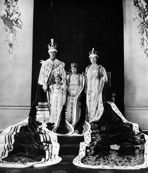 King George VI with his wife and daughters Princesses Elizabeth and Margaret in their coronation robes. Date: 1937