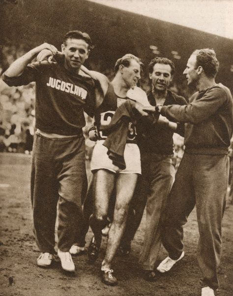 Emil Zatopek (1922 - 2000), Czech long distance runner pictured following his victory in the 10,000m race at the London 1948 Olympic Games, only the second race he had ever run at that distance
