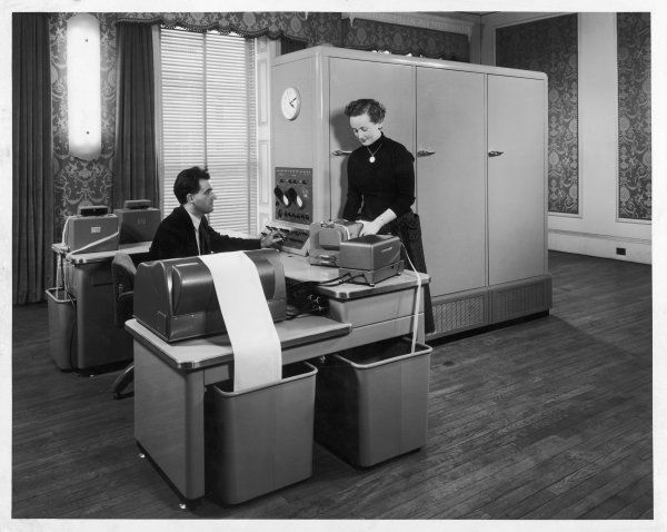 A man and a women working together with a Pegasus computer at Ferranti's London computer Centre, 21 Portland Place, W1. Date: 1950s