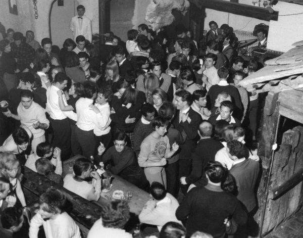 Young people letting their hair down at a discoteque. Date: 1960s