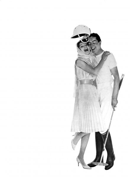 A girl hugs her polo player boyfriend wearing a casual dress by Ronald Paterson in brilliant turquoise shantung. The dress is sleeveless, pleated throughout and cinched at the waist by a wide leather belt. Her beau wears a polo kit from Moss Bros