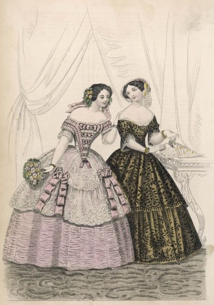 Two gowns: 1 with ruched skirt & lace flounces with ribbons & a ribbon trimmed stomacher corsage; gold dress overlaid with black lace with 2 deep flounces