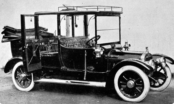 A photograph showing the 20h.p. Austin 'Marlborough' Landaulette. The car had a 10ft wheelbase chasis. Its fitments included a ventilator in the roof, a speaking tube and silk blinds to the frameless windows, which had special winding gear