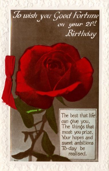 A 21st birthday card with a single red rose, and a matching red ribbon at the side