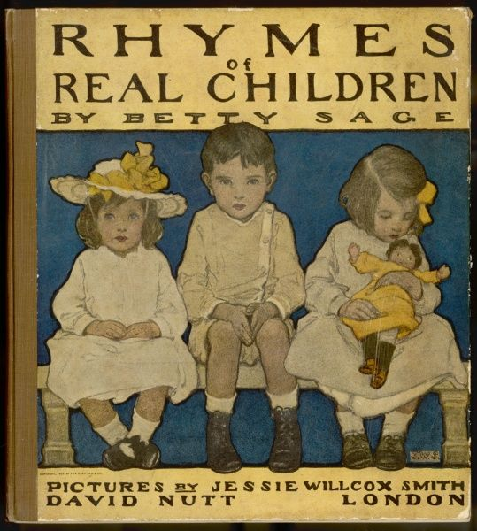 Three well-behaved children, a boy and two girls. The girl on the right cradles her doll