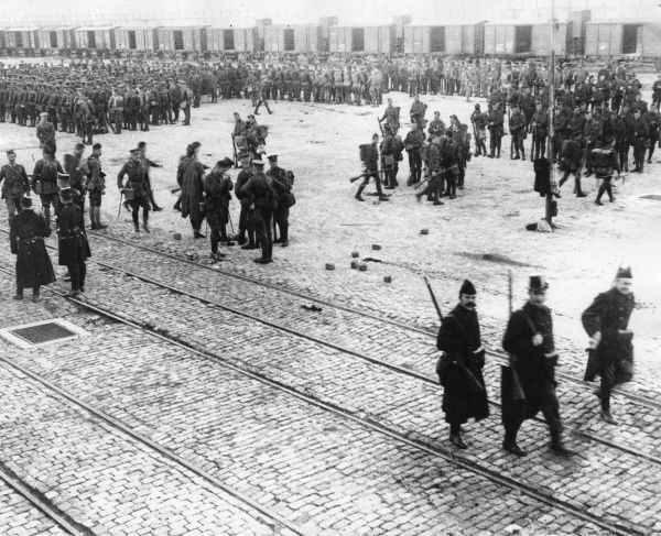 Men of the Belgian 7th Division on the quay at Zeebrugge, Belgium, soon after the start of the First World War. With them are men of the 2nd Scots Guards and 2nd Gordon Highlanders. Date: 7 October 1914