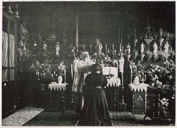 A French renegade priest and practising magician, the Abbe Julio, performs a ceremony of exorcism in his private chapel