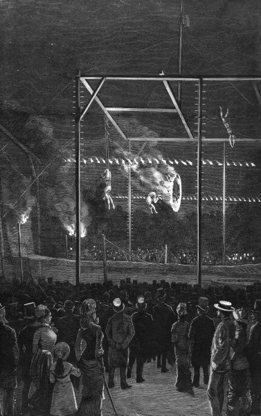 Acrobats risk their lives with fiery hoops over the heads of spectators at Copenhagen's Tivoli Gardens. Date: 1888