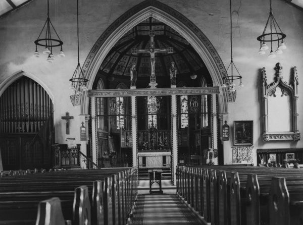 The splendid interior (from the east end) of St. Paul's Church, Addlestone, Surrey, England, with its ornate wrought ironwork. Date: 19th century