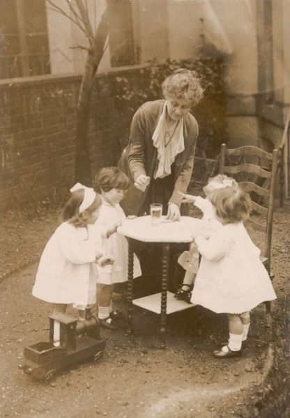 EMMELINE PANKHURST with the four daughters 'war babies' she patriotically adopted
