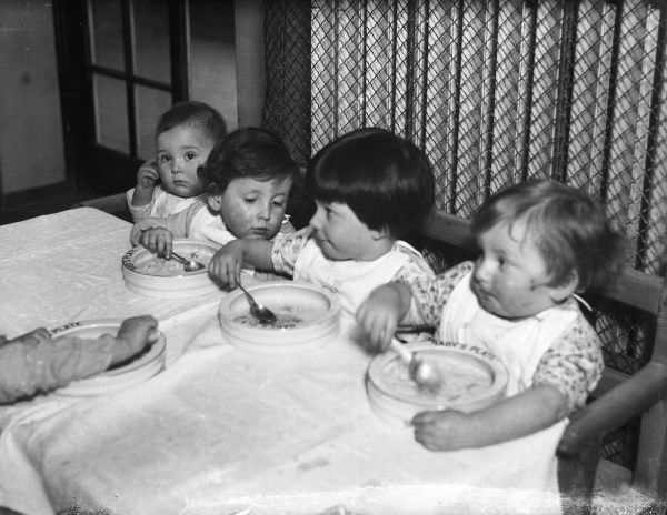 Mealtime for a group of National Adoption Society children