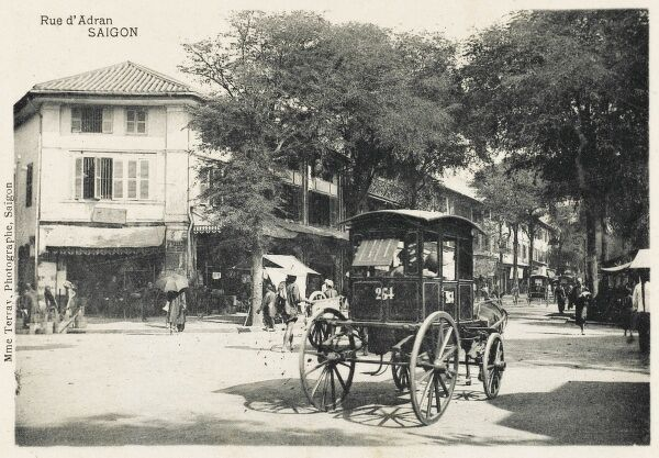 A Horse Cab (Number 264) heading down the Rue d'Adran (Adran Street - Vo duy Nguy Sg), Saigon, Vietnam. The Street is named after the Bishop of Adran, Pierre Pigneau de Behaine (1741 - 1799), a missionary in Saigon in the late 18th century