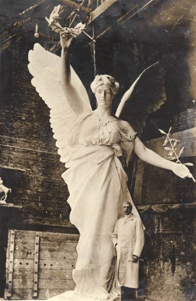 Captain Adrian Jones (1845-1938), sculptor, in his studio with the plaster cast of the allegorical figure of Peace, to be placed in the four-horse chariot (entitled Peace in her Quadriga, completed in 1912) on the Wellington Arch at Hyde Park Corner