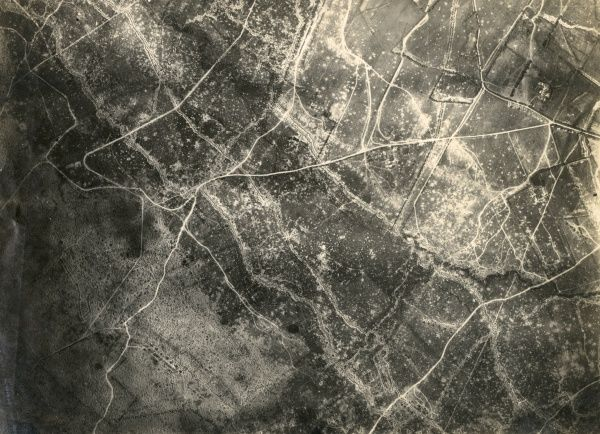 Aerial photograph (German) of a rural battle area on the western front, showing damage from fighting during the First World War. Date: 1914-1918