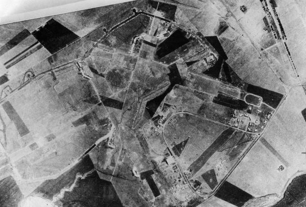 Aerial photograph (British) of a rural area during the First World War, showing fields, roads and buildings. Date: 1914-1918