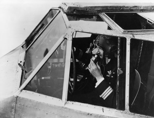 The Captain of H.P. 42 'Heracles' aeroplane, using a Marconi radio. Date: 1931