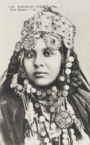 An affluent Algerian Bedouin Woman, her jewellery a brash show of visible wealth